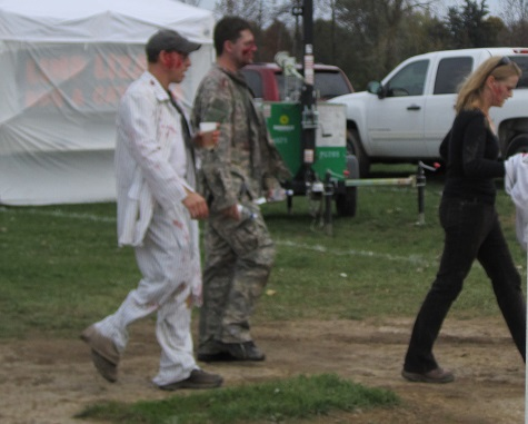 Pre-race festivities. I'm sure these zombies are staring and her tasty brains, not her ass.